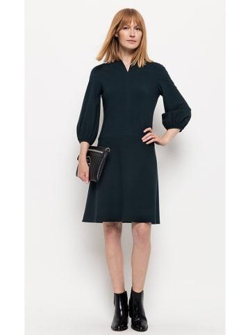 Deni Cler Sukienka w kolorze ciemnozielonym