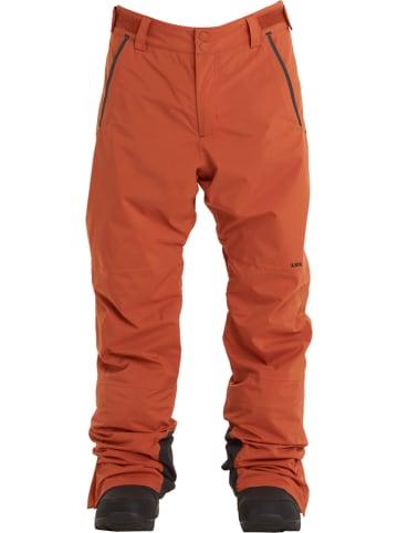 """Billabong Spodnie narciarskie """"Compass"""" w kolorze pomarańczowym"""