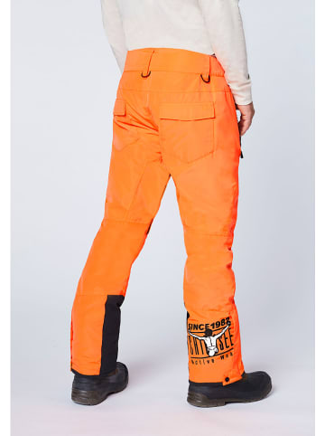 """Chiemsee Spodnie narciarskie """"Taos"""" w kolorze pomarańczowym"""