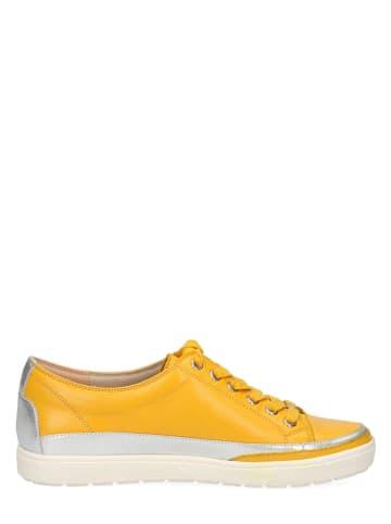"""Caprice Skórzane sneakersy """"Manou"""" w kolorze żółtym"""