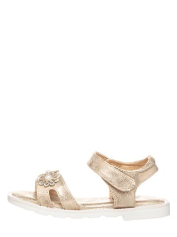 Xti Sandały w kolorze złotym
