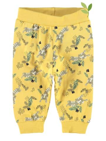 """Name it Spodnie dresowe """"Jack"""" w kolorze żółtym"""