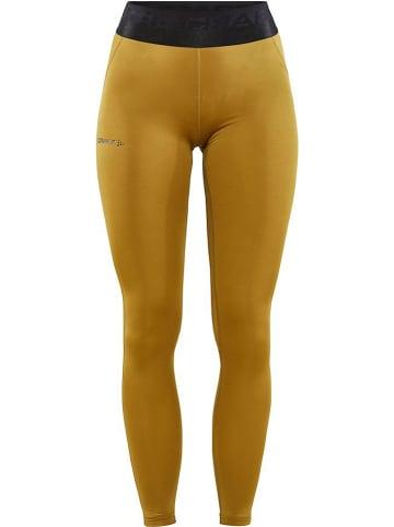 """Craft Legginsy sportowe """"Core"""" w kolorze żółtym"""