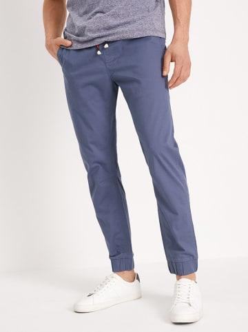 Diverse Spodnie w kolorze niebieskim