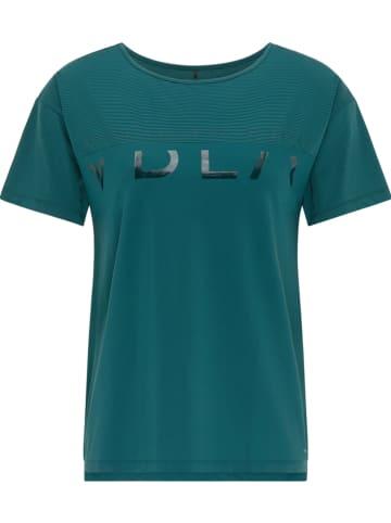 """CURVY FIT BY VENICE BEACH Koszulka sportowa """"Tiana"""" w kolorze turkusowym"""