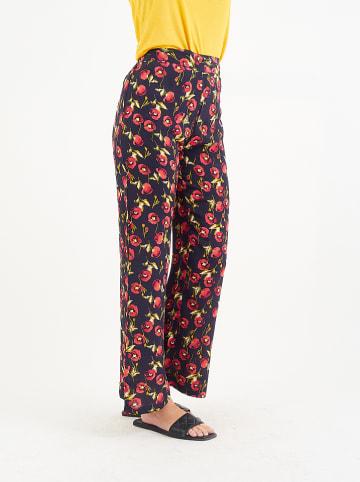 Amichi Spodnie w kolorze granatowym ze wzorem