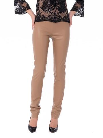 Iren Klairie Spodnie w kolorze jasnobrązowym