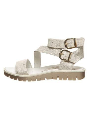 Primigi Skórzane sandały w kolorze złotym