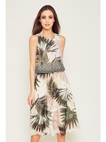 Moda Su Sukienka w kolorze beżowym ze wzorem