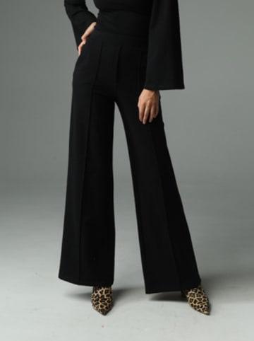 Madnezz Spodnie w kolorze czarnym